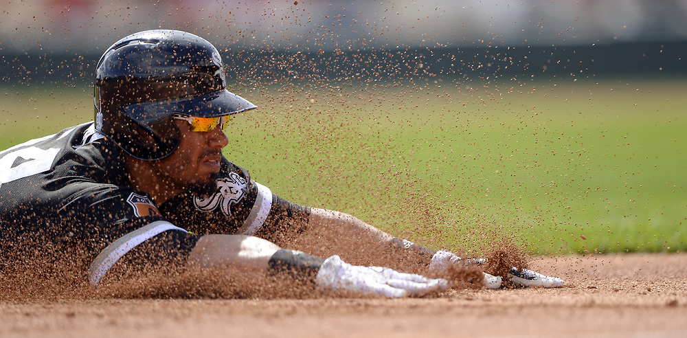 GLENDALE, ARIZONA - MARCH 4:  Jacob May #64 of the Chicago White Sox slides head first into third base with a triple during the spring training game against the Los Angeles Angels of Anaheim on March 4, 2017 at Camelback Ranch in Glendale Arizona.  (Photo by Ron Vesely)   Subject:  Jacob May