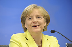 Angela Merkel, Germany's chancellor, smiles during a news conference, following the EU Summit, in Brussels, Friday, June 19, 2009. (Photo © Jock Fistick)