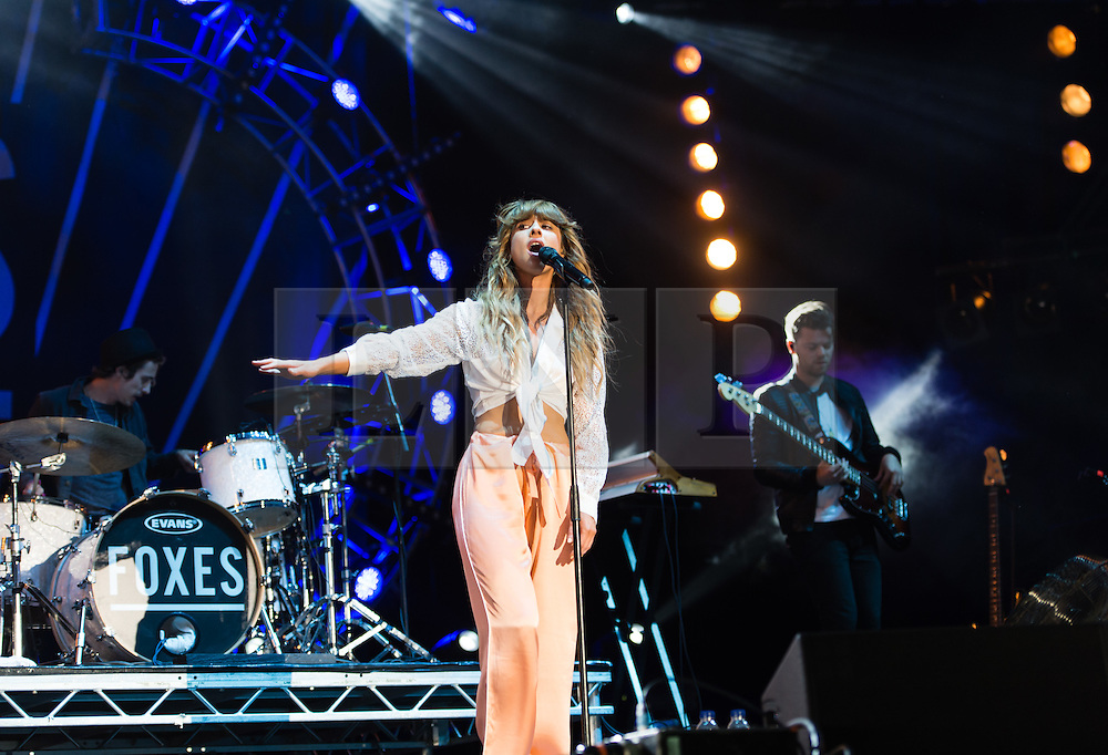 © Licensed to London News Pictures. 13/06/2015. Newport, UK.   Foxes performing live at Isle of Wight Festival 2015, Day 3 Saturday.  Foxes is Louisa Rose Allen .  This afternoon as started with warm sunshine.  Yesterday the rain was torrential.  Headline acts include The Prodigy, Blur and Fleetwood Mac.   Photo credit : Richard Isaac/LNP