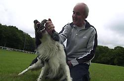 Eddie Sander with his Dogs Jackson and Inka<br /><br />18 June 2004<br /><br />Copyright Paul David Drabble<br /> [#Beginning of Shooting Data Section]<br />Nikon D1 <br /> Focal Length: 17mm<br /> Optimize Image: <br /> Color Mode: <br /> Noise Reduction: <br /> 2004/06/18 09:36:40.5<br /> Exposure Mode: Manual<br /> White Balance: Auto<br /> Tone Comp: Normal<br /> JPEG (8-bit) Fine<br /> Metering Mode: Center-Weighted<br /> AF Mode: AF-S<br /> Hue Adjustment: <br /> Image Size:  2000 x 1312<br /> 1/200 sec - F/8<br /> Flash Sync Mode: Not Attached<br /> Saturation: <br /> Color<br /> Exposure Comp.: 0 EV<br /> Sharpening: Normal<br /> Lens: 17-35mm F/2.8-4<br /> Sensitivity: ISO 200<br /> Image Comment: <br /> [#End of Shooting Data Section]