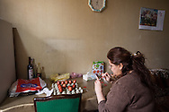 Maral, a Syrian-Armenian from Aleppo prepares traditional painted eggs for their familes' Easter celebration.