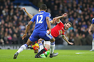 Juan Mata of Manchester United battles with Chelsea's Mikel John Obi during the Barclays Premier League match between Chelsea and Manchester United at Stamford Bridge, London, England on 7 February 2016. Photo by Phil Duncan.