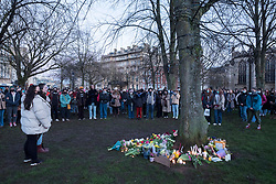 © Licensed to London News Pictures;13/03/2021; Bristol, UK. Hundreds of people defy covid lockdown restrictions on public events to lay flowers and notes in remembrance on College Green in memory of woman Sarah Everard whose body was confirmed found in Kent yesterday. A police officer has been charged with her murder. Vigils across the the country had been planned but were supposed to be cancelled because of the Covid-19 coronavirus pandemic Lockdown restrictions in England. Photo credit: Simon Chapman/LNP.