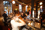 New York, NY - April 11, 2015: A bartender shakes cocktails at a reception during the Food Book Fair in the Wythe Hotel. The Food Book Fair, dubbed the 'Coachella of writing about eating' by organizer Kimberly Chou, brings together authors, chefs, publishers and food aficionados to discuss the state of food publishing.<br /> <br /> © CREDIT: Clay Williams for Food Book Fair.<br /> <br /> Clay Williams / claywilliamsphoto.com