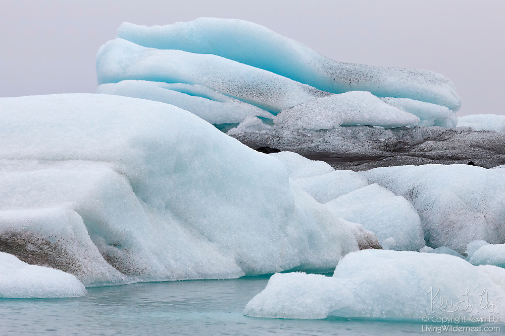 Large icebergs float in the glacial lagoon of Jökulsárlón in southern Iceland. The glacial lake is full of icebergs that have fallen from the Breiðamerkurjökull glacier.
