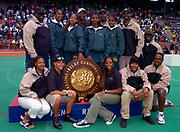 The Long Beach Poly High (Calif.) coaches Don Norford, Clarence Rhone, Crystal Irving, John Atkinson and Rob Shock pose with girls 4 x 400m relay that won iin 3:36.85 in the 110th Penn Relays at University of Pennsylvania's Franklin Field on Friday, April 23, 2004 in Philadelphia.