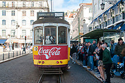 Yellow heritage tram No. 12 on the street of Lisbon. Lisbon tramway network operates since 1873