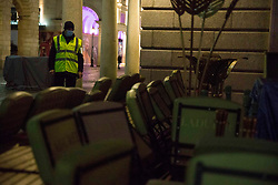 © Licensed to London News Pictures.31/12/2020, London, UK. A lone security man in Covent Garden as three quarters of England plunged into Tier 4 last night. This New Year's Eve Londoners need to stay at home according to Tier 4 guidelines. Photo credit: Marcin Nowak/LNP