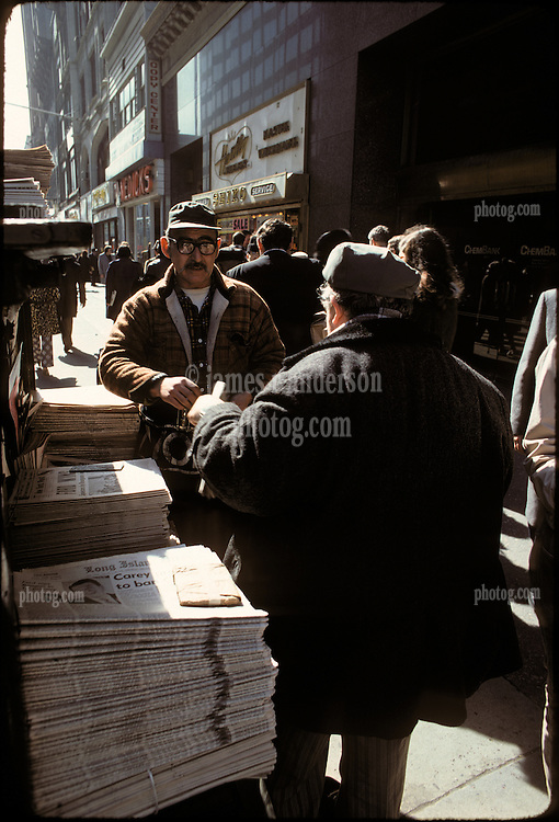 """Newstand selling papers with """"Ford Wins"""" the primary, Brooklyn, New York City, February 25, 1976"""