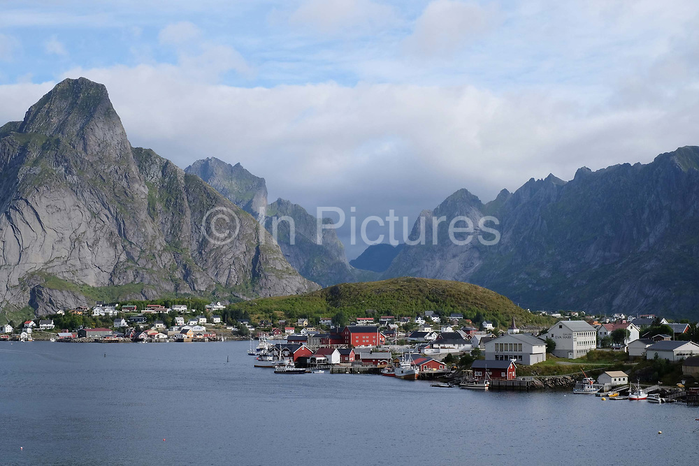 The village of Reine on 25th August 2016 in Lofoten, Norway. The Lofoten islands are famous for their jagged mountains, red-painted rorbu cabins and racks with fish hanging closely packed to dry.