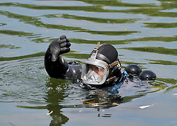 © licensed to London News Pictures. RICHMOND, UK.  01/08/11. A police diver at the scene. The Metropolitan police search the River Thames near Richmond, London, today (1 Aug 2011) after a 17 year boy went missing after taking part in a kayak competition.  Mandatory Credit Stephen Simpson/LNP
