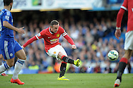 Wayne Rooney, the Manchester United captain taking a shot at goal. Barclays Premier league match, Chelsea v Manchester Utd at Stamford Bridge Stadium in London on Saturday 18th April 2015.<br /> pic by John Patrick Fletcher, Andrew Orchard sports photography.