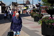 Elderly woman out shopping in Stratford in East London. This is a relatively poor area of London, but in recent years has seen much regeneration, the construction of a major transport hub and various shopping complexes. Stratford is adjacent to the London Olympic Park and is currently experiencing regeneration and expansion linked to the 2012 Summer Olympics. (Photo by Mike Kemp/For The Washington Post)