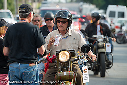 Steve DeCosa riding his 1927 Harley-Davidson JD arrives at check-in at the finish before the hosted Dinner stop on Spanish Street in Cape Girardeau, Missouri during Stage 5 of the Motorcycle Cannonball Cross-Country Endurance Run, which on this day ran from Clarksville, TN to Cape Girardeau, MO., USA. Tuesday, September 9, 2014.  Photography ©2014 Michael Lichter.