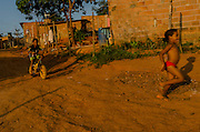 Kids enjoying a sunny afternoon in Rosa Leão Occupancy, Isidoro area. Without easy access to electronic entertainment devices, children use to spend their free time playing outdoor.