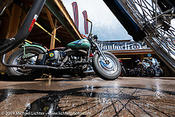 Antique Harley-Davidson Flathead in the Broken Spoke area of the Sturgis Iron Horse Saloon during the Sturgis Black Hills Motorcycle Rally. Sturgis, SD, USA. Sunday, August 4, 2019. Photography ©2019 Michael Lichter.
