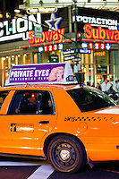 taxis in evening street scene in New York City October 2008