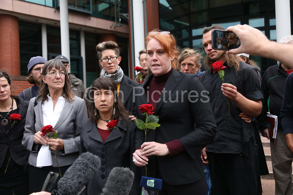 "Michelle Easter, partner of Richard Roberts speaks out to press in reaction to the sentence September 26 2018, Preston crown court, Preston, United Kingdom. Simon Roscoe Blevins, 26,  Richard Roberts, 36 were both sentenced 16 months in prison, Richard Loizou, 31, sentenced 15 months in prison and  and Julian Brock, 47 12 months supended. Simon Roscoe Blevins, 26,  Richard Roberts, 36 were both sentenced 16 months in prison, Richard Loizou, 31, sentenced 15 months in prison and  and Julian Brock, 47 12 months supended. Simon Roscoe Blevins, 26,  Richard Loizou, 31, Richard Roberts, 36 and Julian Brock, 47 climbed on top of several trucks during a mass protest by locals and supporters in New Preston Road, against fracking in Lancashire, July 2017. The trucks were prevented form delivering equipment to Cuadrillas nearby fracking site for four days. After a seven day jury trial at Preston Crown Court in August 2018, the four men were found guilty of Public Nuisance. Judge Altham has told them to expect ""immediate custodial sentences"" on 25th September 2018."