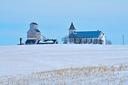 Grain elevator and church in winter<br /> Horizon<br /> Saskatchewan<br /> Canada