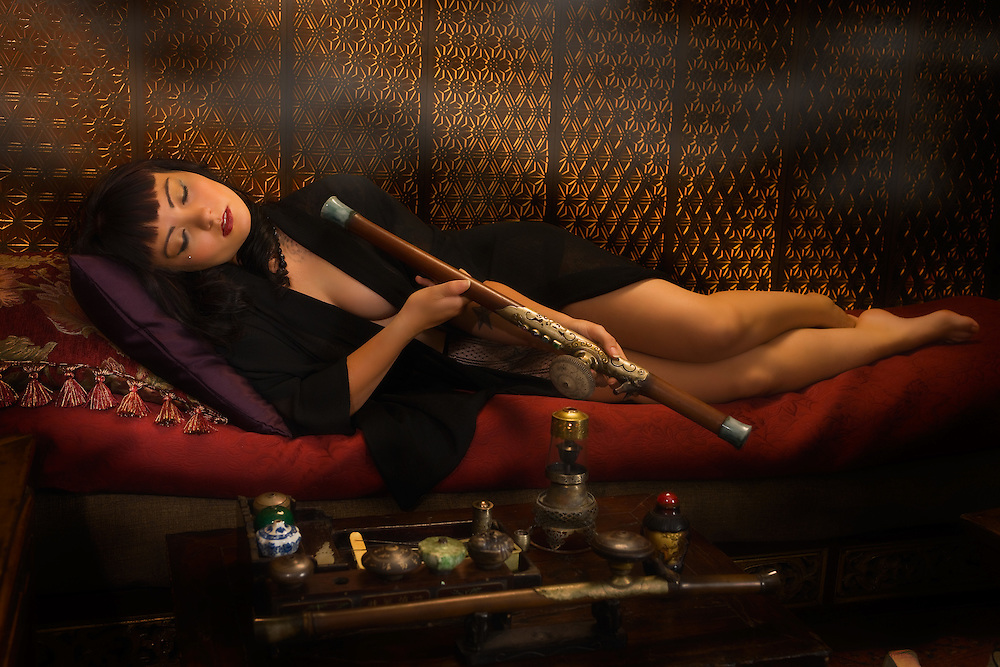 """Am I not desirable? Seductive, beautiful woman portrayed by alternative model Sabrina Sin, smoking opium in an ornate pipe, a forbidden pleaure among the liberated French females of the 1930's. She is being carried away by the effects of the drug surrendering herself to the drug. This collection was inspired by the writings of Brassai in his book """"The Secret Paris of the 1930's""""."""