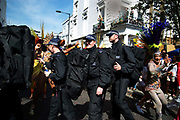 Notting Hill Carnival August 28th 2017. West London, England. A group of special forces police in black uniforms carring big kitbags walk through the parade.