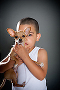 Zechariah Beatty with 15-week-old chihuahua mix Reese.