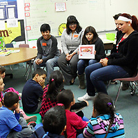 New Mexico State University students in a Spanish heritage class read books to dual-language students at César Chávez Elementary. The students wrote and illustrated the bilingual children's books as a class project. (submitted  photo) DEC11