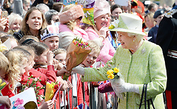 File photo dated 21/04/16 of Queen Elizabeth II meeting well wishers during a walkabout close to Windsor Castle in Berkshire as she celebrated her 90th birthday.