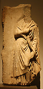 Part of a marble grave relief.  AD 160-180.  Himation-clad female figure, statue of the 'Large Herculaneum woman', a creation associated with the oeuvre of Prazitel.