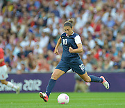 Wembley, Great Britain,USA Mid fielder, Carli LLOYD in full fight as she carries the ball foreward, during the USA Women's Football Team 2-1 win over Japan to win the Gold Medal 2012 London Olympic, Women's Football, Gold Medal Match, at Wembley Stadium, USA vs Japan, 20:05:29  Thursday  09/08/2012 [Mandatory Credit: Peter Spurrier/Intersport Images],