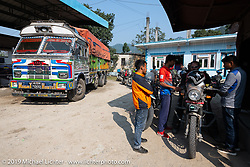Jason Adamski at a gas station on Motorcycle Sherpa's Ride to the Heavens motorcycle adventure in the Himalayas of Nepal. Riding from Chitwan to Daman. Tuesday, November 12, 2019. Photography ©2019 Michael Lichter.