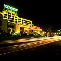 Traffic streaks by a hotel in Vientiane, Laos