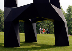 © Licensed to London News Pictures. 24/05/2012. Waddesdon, UK. People walk through the grounds seen through a sculpture by John Pawson. People enjoy the warm weather amongst an exhibition of contemporary sculpture at Waddesdon Manor, Buckinghamshire, today 24th May 2012. The exhibition is being held by Christie's as part of a private sale. Photo credit : Stephen Simpson/LNP