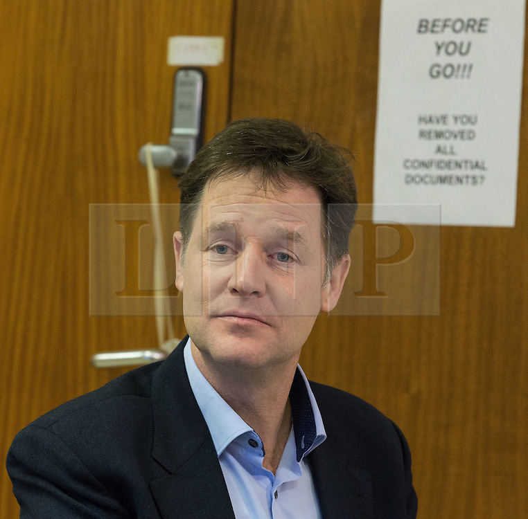 """© Licensed to London News Pictures . FILE PICTURE DATED 15/01/2015 of The Deputy Prime Minister , NICK CLEGG , in front of a sign reading """" Before you go have you removed all confidential documents """" during a visit to Liverpool . The Liberal Democrat party leader has spoken out against the """" Snoopers Charter """" which would enable government power to view everyone's social media and internet activity . Photo credit : Joel Goodman/LNP"""