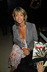 SABRINA GUINNESS at a party to celebrate the first 20 years of fashion label Donna Karan held at her store at 19/20 New Bond Street, London W1 on 21st September 2004.<br />