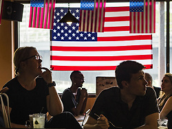 November 9, 2016 - Bangkok, Bangkok, Thailand - Members of Democrats Abroad Thailand watch election results come in Wednesday morning (Thai time). Democrats Abroad Thailand met at the Roadhouse Barbecue, an American restaurant in Bangkok to watch election results come in. It was a somber election watch party as what was expected to be a Clinton victory turned into a Trump win. (Credit Image: © Jack Kurtz via ZUMA Wire)