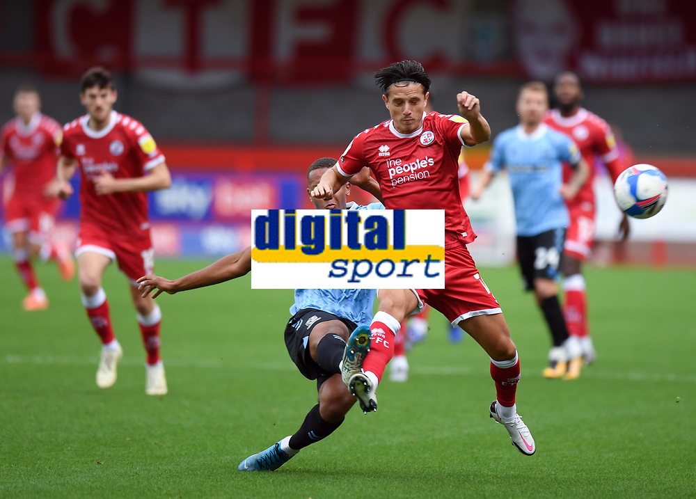 Football - 2020 / 2021 Sky Bet League Two - Crawley Town vs Southend United - The People's Pension Stadium.<br /> <br /> Crawley Town's Tom Nichols is tackled by Southend United's Shaun Hobson.<br /> <br /> COLORSPORT/ASHLEY WESTERN