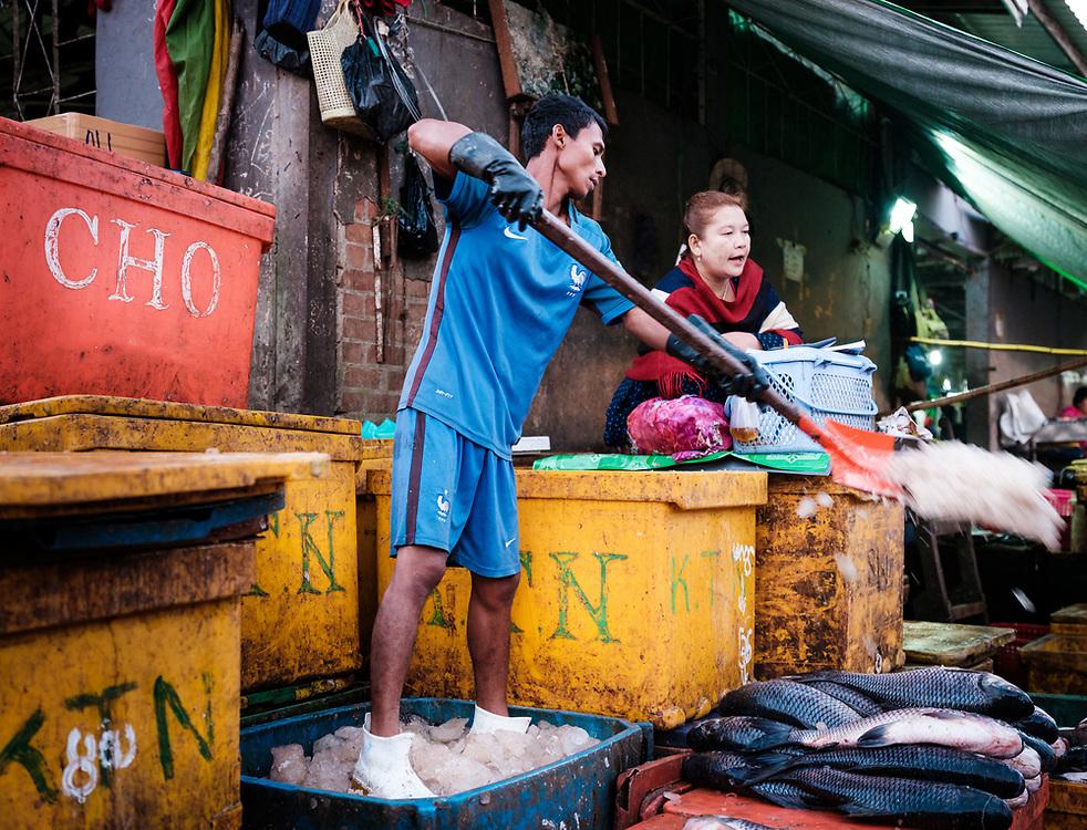 YANGON, MYANMAR - Street vendor on the Yangon Fish Market early morning.