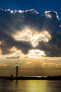 Heart shaped clouds during a sunset on the Gulf Coast with lighthouse in the foreground