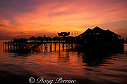 Sipadan Water Village Resort at sunset, <br /> Mabul Island, off Borneo, <br /> Sabah, Malaysia ( Celebes Sea )