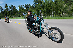 Eric Greenfield of Denver riding his Bubblicious S&S Shovelhead chopper on the Cycle Source Ride up Vanocker Canyon to Nemo during the Sturgis Black Hills Motorcycle Rally. SD, USA. Wednesday, August 7, 2019. Photography ©2019 Michael Lichter.