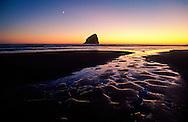 View of water and Haystack Rock at sunset, Cape Kiwanda, Oregon