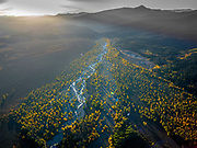 Editions of 8<br /> Aerial view of Spread Creek at sunrise just before joining the Snake River along Teton Mountain Range Autumn Color.