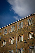 Safety netting hangs across the outdoor exercise yard between the prison wing and internal fence in Her Majesty's Prison Pentonville, London, United Kingdom.  These nets were introduced to stop drones flying over the prison and delivering items to prisoners. (Photo by Andy Aitchison)