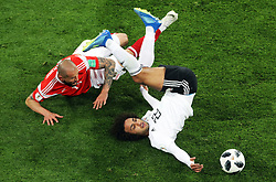 Russia's Fyodor Kudryashov (left) and Egypt's Amr Warda battle for the ball during the FIFA World Cup 2018, Group A match at Saint Petersburg Stadium.