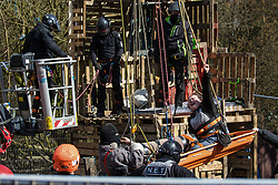 Bailiffs from the National Eviction Team (NET) remove two anti-HS2 activists who are locked together from a makeshift tower in Denham Country Park where they had been seeking to delay electricity pylon relocation works by Babcock in connection with the HS2 high-speed rail link on 22nd March 2021 in Denham, United Kingdom. Activists continue to oppose the controversial infrastructure project from a series of protest camps along its Phase 1 route between London and Birmingham.