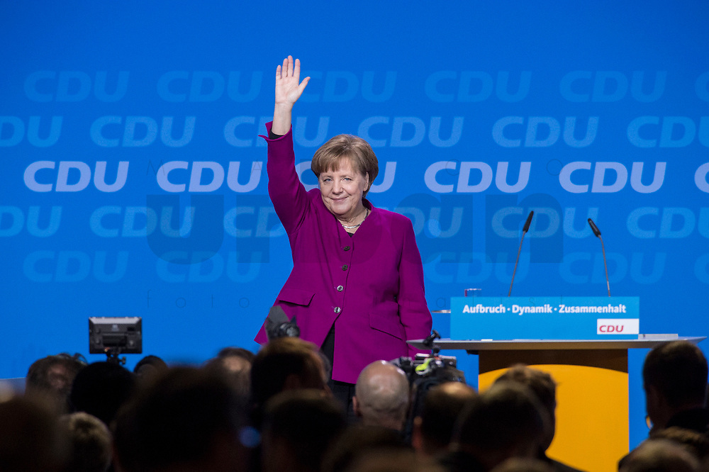 26 FEB 2018, BERLIN/GERMANY:<br /> Angela Merkel, CDU, Bundeskanzlerin, nimmt nach ihrer Rede den Applaus der Delegierten entgegen, CDU Bundesparteitag, Station Berlin<br /> IMAGE: 20180226-01-089<br /> KEYWORDS: Party Congress, Parteitag