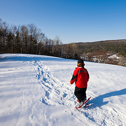 A young boy (age 5) snowshoes at the Tyringham Cobble Reservation in Tyringham, Massachusetts.  Berkshire Mountains. The Trustees of Reservations.