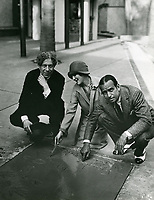 1927 Mary Pickford and Douglas Fairbanks' hand/footprint ceremony at Grauman's Chinese Theater with Sid Grauman