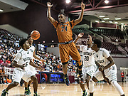 Jason Lester of Dobie loses the ball on a shot attempt during a game Tuesday March 1, 2016. Hightower played Dobie in a boys basketball playoff game at the Campbell Center. (Michael Starghill, Jr.)